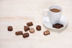 Glass of chocolate milk and variety chocolates  on table Stock Images