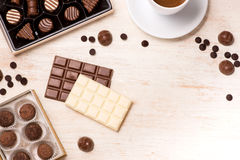Glass of chocolate milk and variety chocolates  on table Stock Image