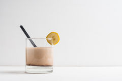 Glass of chocolate milkshake Royalty Free Stock Images