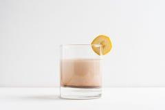 Glass of chocolate milkshake royalty free stock photography