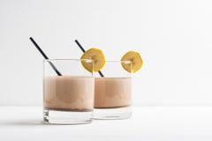 Glass of chocolate milkshake stock images