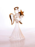Glass Christmas angel. A glass Christmas angel ornament with gold halo and star against a white backgroun Stock Photography