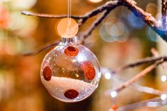 Glass Christmas ball decoration partly filled with white balls and with reed spots stock photos