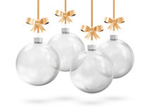 Glass Christmas Balls. Hanging on Golden Ribbons on white background Royalty Free Stock Image
