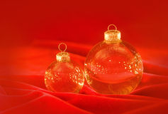Glass christmas balls on red Stock Image