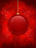 Glass christmas bauble background. Red glass Christmas bauble on a glowing red background with gold glitter Stock Photos