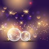Glass Christmas bauble background. Christmas baubles on a bokeh lights background Royalty Free Stock Images