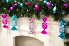 Glass Christmas candy hanging on the mantelpiece. Glass Christmas candy hanging from a garland on the mantelpiece Stock Photo