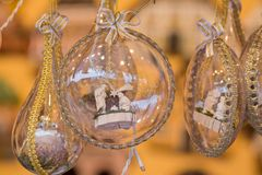 Glass Christmas globes with golden bows Royalty Free Stock Images