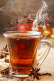 Glass of christmas hot steaming tea Stock Images