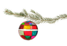 Glass Christmas Ornament. Handmade Christmas ornament hanging from a pine branch set against a white background Stock Images