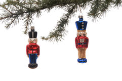 Glass Christmas Ornament. Two soldier glass ornaments hanging from a pine branch set against a white background Stock Image