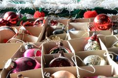 Glass christmas spheres in their cardboard boxes. Retro style christmas spheres in the original cardboxes Royalty Free Stock Photography
