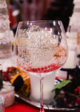 Glass on a christmas table Royalty Free Stock Photography