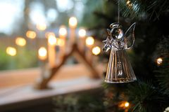 Free Glass Christmas Tree Decoration Hanging Near A Window With A Traditional Candle Arch Or Bridge In Blurred Background Royalty Free Stock Photos - 108484608