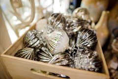 Glass Christmas tree decoration toys in the form of silver balls in a wooden box royalty free stock photos