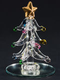 Glass christmas tree over black background Stock Images