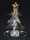 Glass christmas tree over black background Royalty Free Stock Images