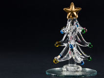 Glass christmas tree over black background Stock Photo