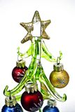 Glass Christmas tree with toys. Christmas tree made of glass with colorful toy balls royalty free stock images