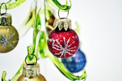 Glass Christmas tree with toys. Christmas tree made of glass with colorful toy balls stock photos
