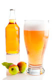 Glass Of Cider. With apples and bottle on white background stock image