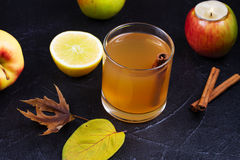 Glass of cider, apples and lemon. Royalty Free Stock Photography