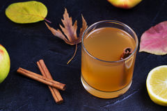 Glass of cider, apples and lemon. Stock Images