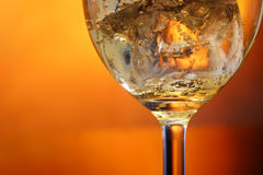 Glass of cider and ice Royalty Free Stock Images