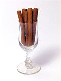 Glass of Cinnamon. Liquor glass filled with cinnamon sticks Stock Photo