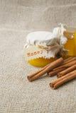A glass of cinnamon honey Stock Photo