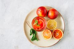 Glass of citrus infused water with mint. Blood oranges and lemon royalty free stock photos