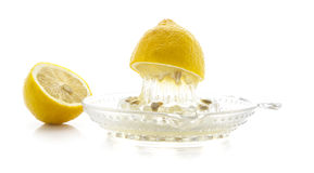 Glass citrus squeezer with lemons Stock Image