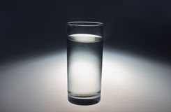 Glass of clean clear cool water. A tall glass of clean clear cool water Royalty Free Stock Images