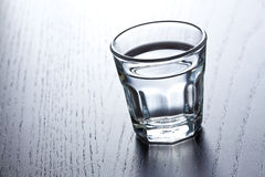 Glass of clear alcohol Stock Photography