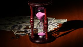 Glass clock with pink sand. Close up stock footage