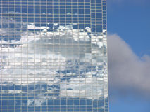 Glass and Clouds. Clouds reflecting on the glass of a skyscraper stock photos