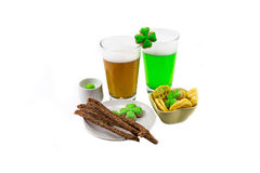 Glass of clover light snack on a white background a spicy evening at the pub. saint Patrick `s Day royalty free stock photos