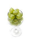 Glass and cluster of vine. On a white background Stock Photos