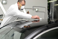 Glass coating. Black car polish shine restoring the protective coating royalty free stock photos