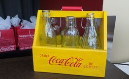 Glass Coca Cola Bottles. In yellow wood crate stock images