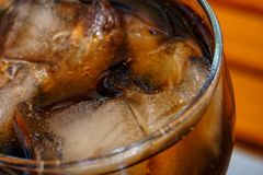 Glass of coca cola. Close up of a glass of coca cola with ice royalty free stock images