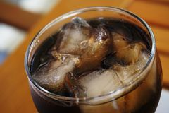 Glass of coca cola with ice. Close up of a glass of coca-cola with ice cubes stock images
