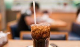 Glass with coca cola and ice close-up. Stock Images