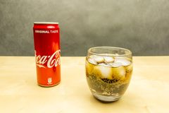 A glass of Coca-Cola with ice cubes. stock images