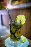 Glass of coca tea with slice of lemon wedge Royalty Free Stock Photo