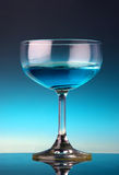 Glass of cocktail. A glass of blue drink cocktail with blue background Stock Photo