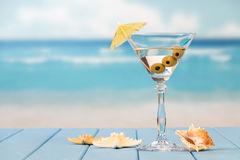 Glass of cocktail at the beach Royalty Free Stock Images