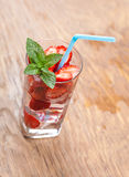 Glass of cocktail and berries closeup Stock Images