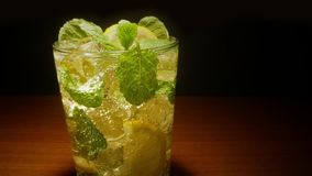 Mojito cocktail. Glass of Cocktail with lemon, mint, ice stock video footage
